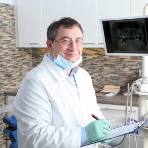 Dentist with prior claims and professional liability insurance working on patient